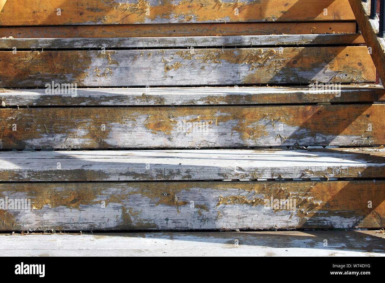 Well worn, paint faded close up of three steps in the late afternoon sunshine. Ottawa, Ontario, Canada. Stock Photo