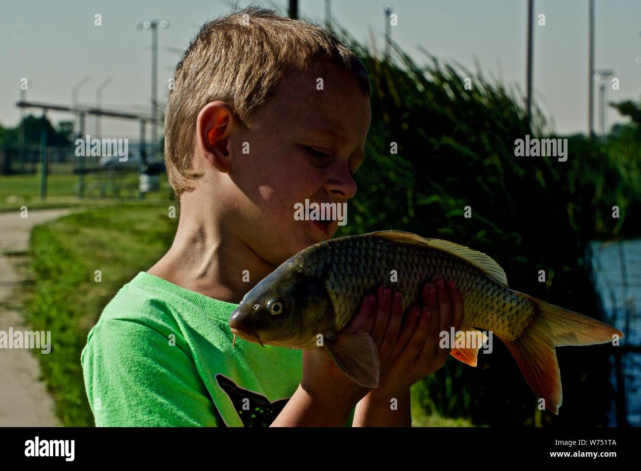 My Grandson, Connor with his First Fish, River Carp, Lindsey Park Public Fishing Lake, Canyon, Texas. Stock Photo