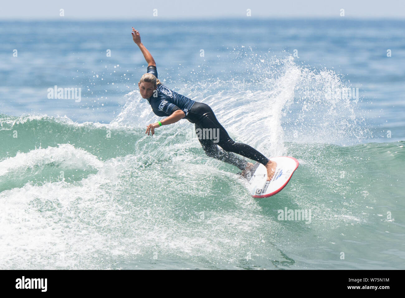 Orange County, USA. 4th Aug, 2019. Sage Erickson of the United States competes during the women's final of Vans US Open of Surfing at Huntington Beach, California, the United States, on Aug. 4, 2019. Credit: Qian Weizhong/Xinhua/Alamy Live News Stock Photo