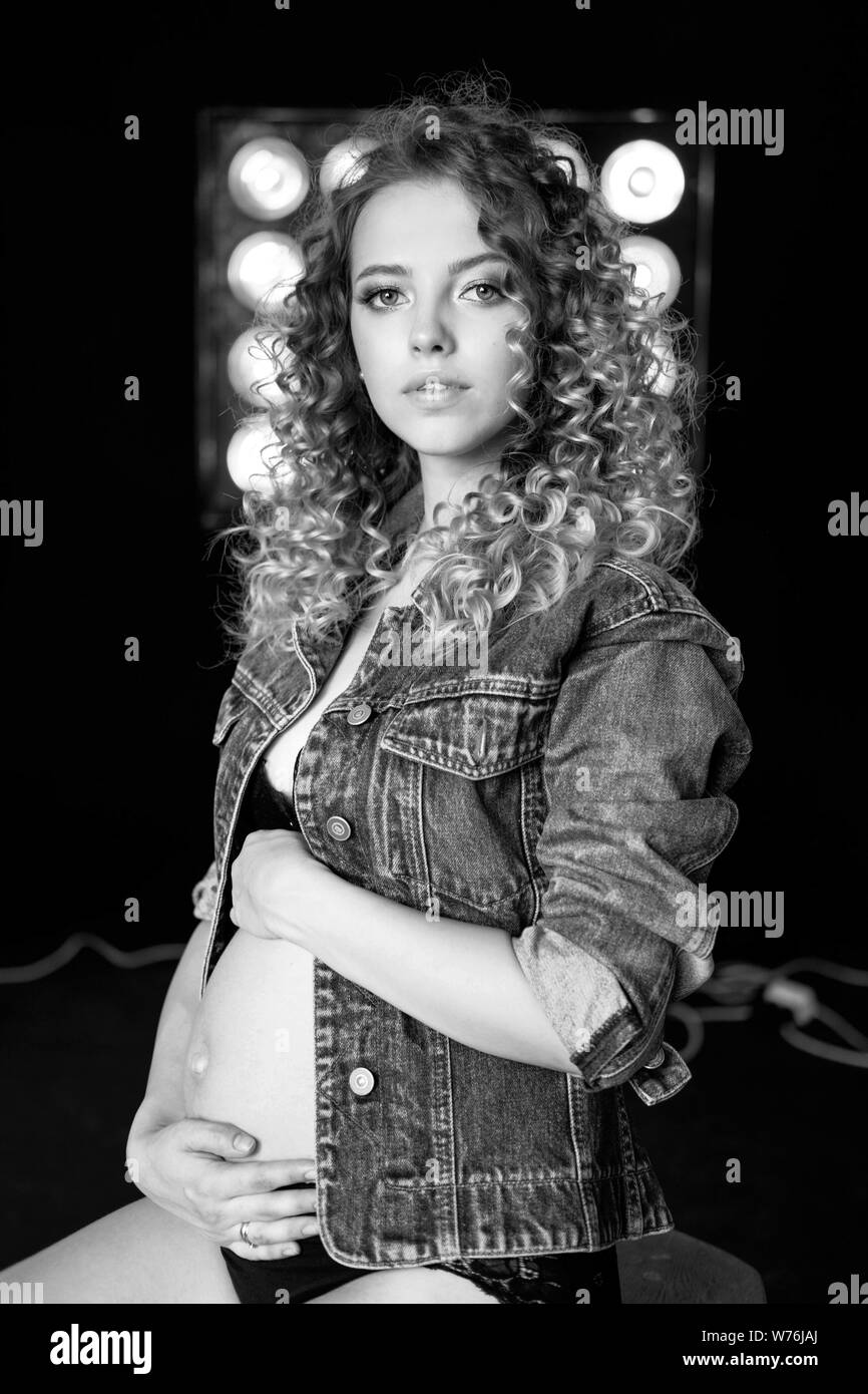 Pregnant Young Beautiful Fashion Blonde Model Woman In Denim Jacket In Studio Wait Baby Black And White Photo Stock Photo Alamy