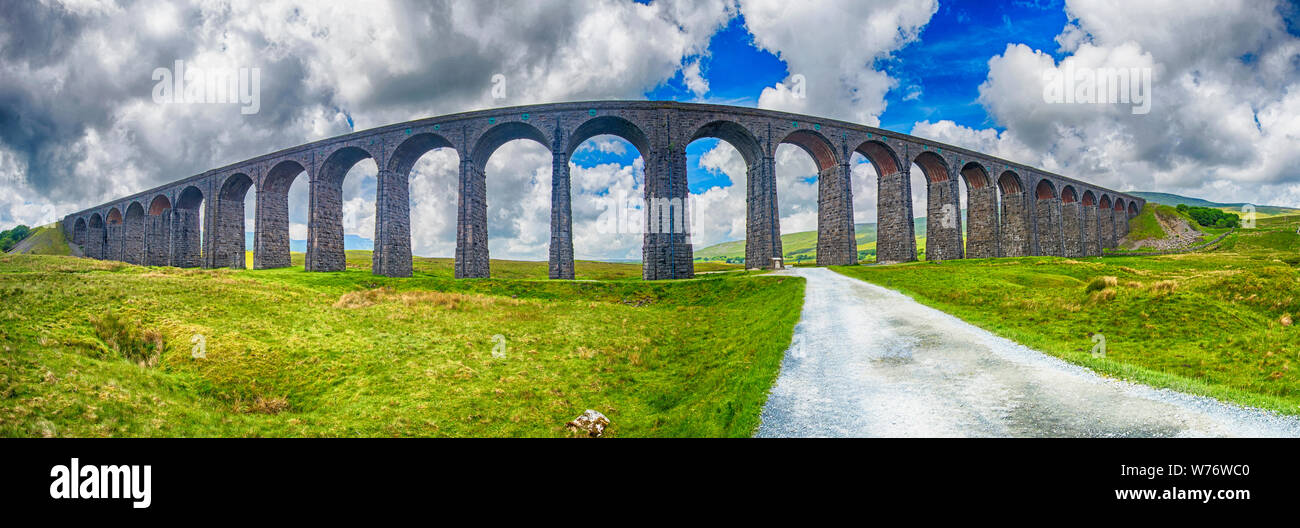 View of a large old Victorian railway viaduct across valley in rural countryside scenery panorama Stock Photo