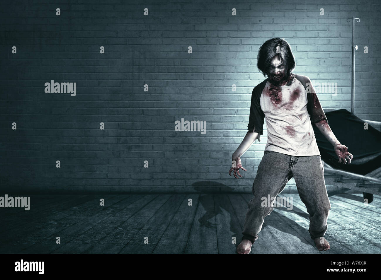 Scary zombies with blood and wound on his body haunted the abandoned hospital. Halloween concept Stock Photo