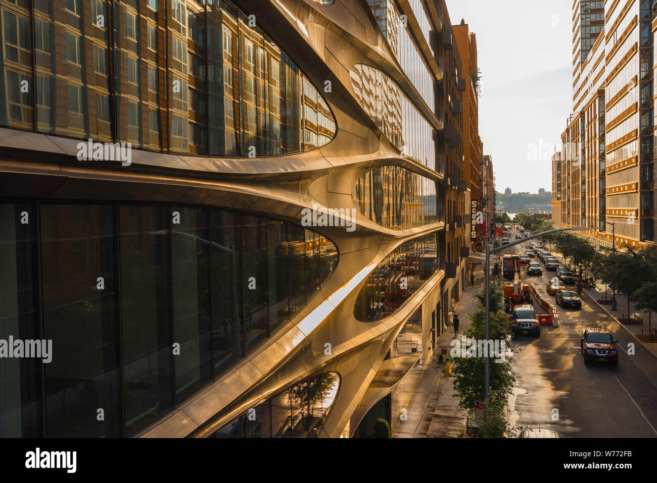 Manhattan architecture, view at sunset along West 28th Street in Chelsea with facade of 520 West 28th Street building by Zaha Hadid on left, New York. Stock Photo