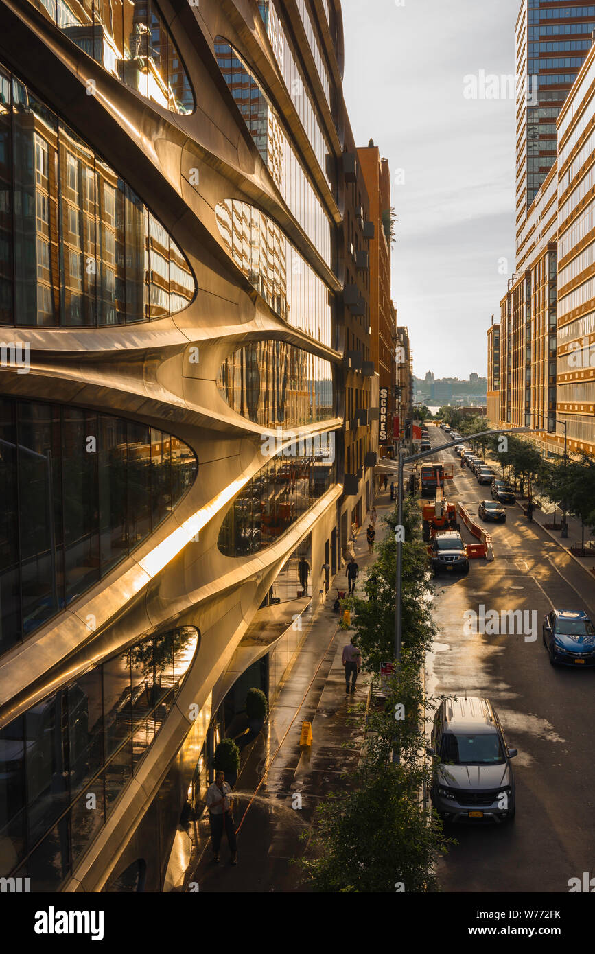 New York architecture, view at sunset along West 28th Street in Chelsea with facade of 520 West 28th Street building by Zaha Hadid on left, New York. Stock Photo