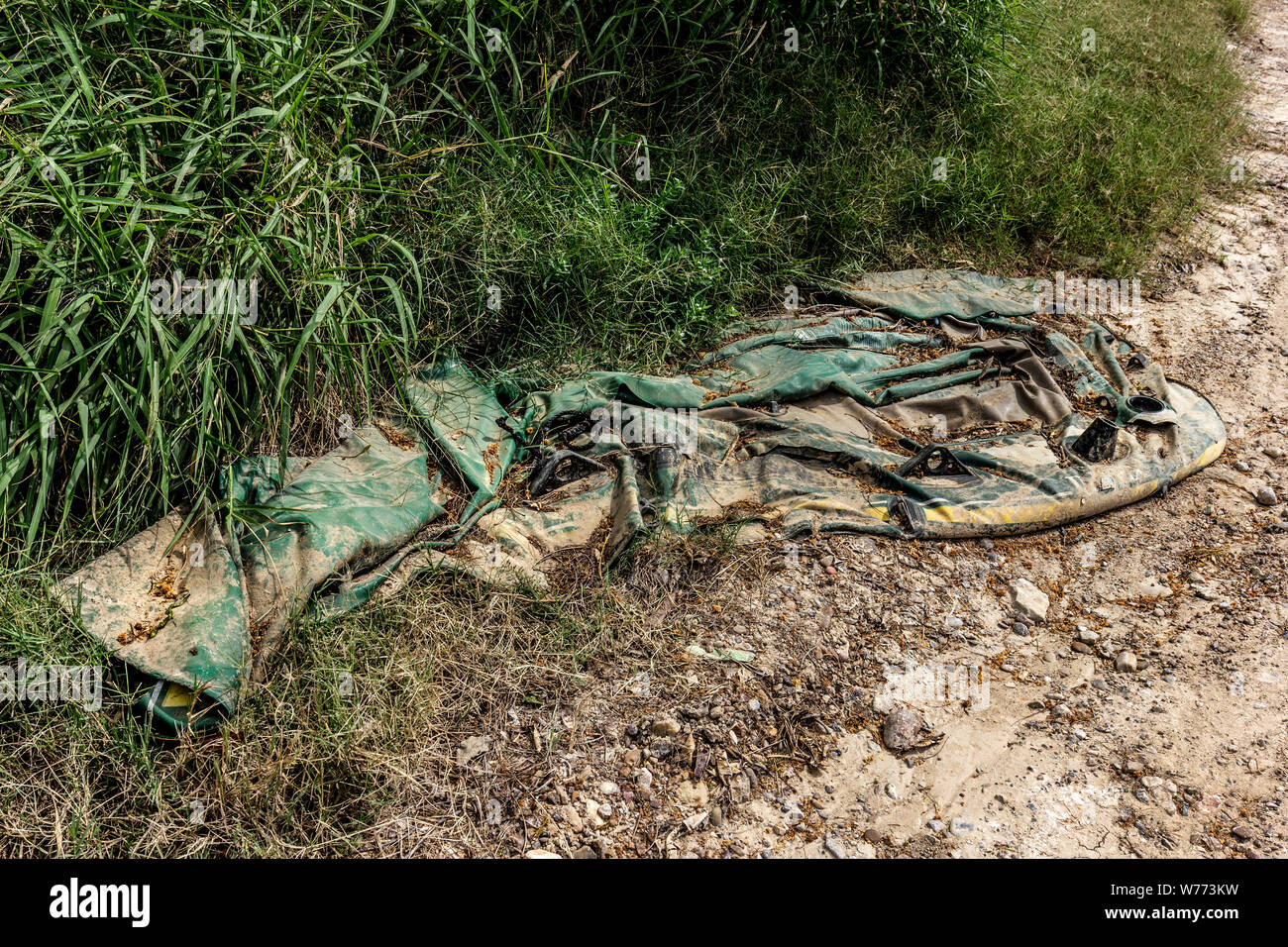 Discarded rafts used by migrants to cross the Rio Grande River, found on the USA side in Roma, Texas, USA Stock Photo