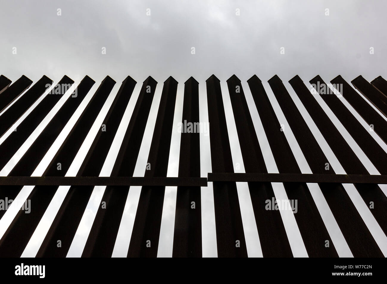A portion of the high steel border fence, Brownsville, Texas, USA. Stock Photo
