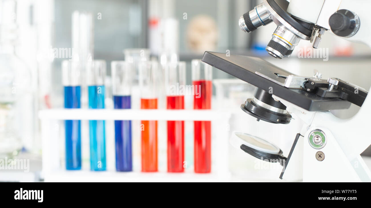 Microscope and glass tube in research laboratory concept. Stock Photo