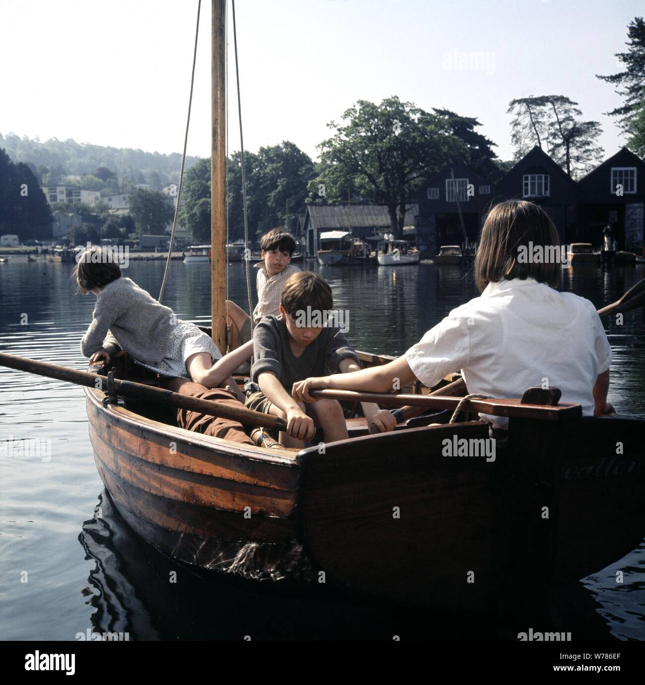 Sophie Neville, Stephen Grendon, Simon West & Suzanna Hamilton Film: Swallows And Amazons (UK 1974)  Character(s): Titty Walker - Swallow, Roger Walker - Swallow, John Walker - Swallow, Susan Walker - Swallow  Director: Claude Whatham 04 April 1974  SAN54015 Allstar Picture Library/STUDIOCANAL  **Warning** This Photograph is for editorial use only and is the copyright of STUDIOCANAL  and/or the Photographer assigned by the Film or Production Company & can only be reproduced by publications in conjunction with the promotion of the above Film. A Mandatory Credit To STUDIOCANAL is required. The P Stock Photo