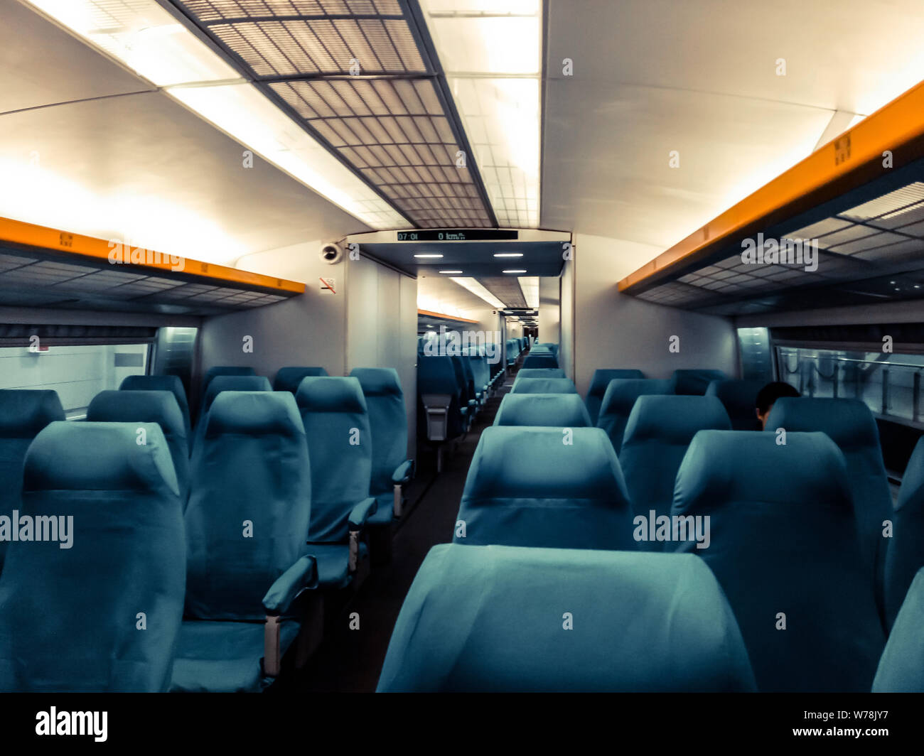 Image with the interior of a china border train. A modern train with comfortable and colorful chairs Stock Photo