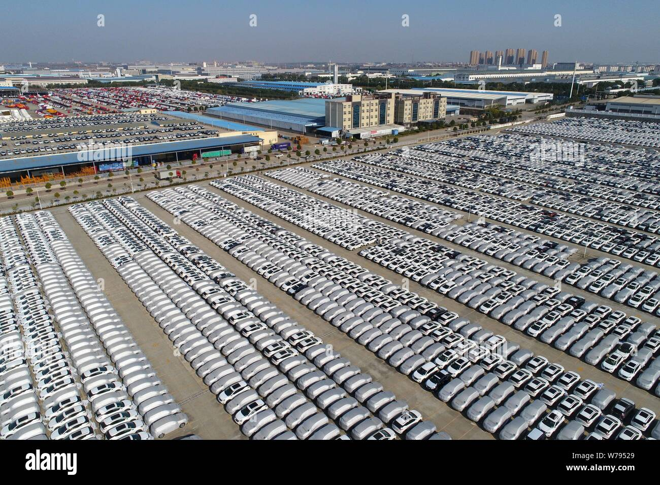 Aerial view of massive new vehicles lined up for sale at an automobile plant in Xiangyang city, central China's Hubei province, 26 November 2017.   Ma Stock Photo