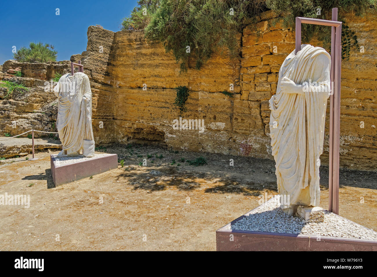 Headless Roman statues on display in archaeological site. Two torso marble statues exhibited at Valley of the Temples Park in Agrigento Sicily Italy. Stock Photo