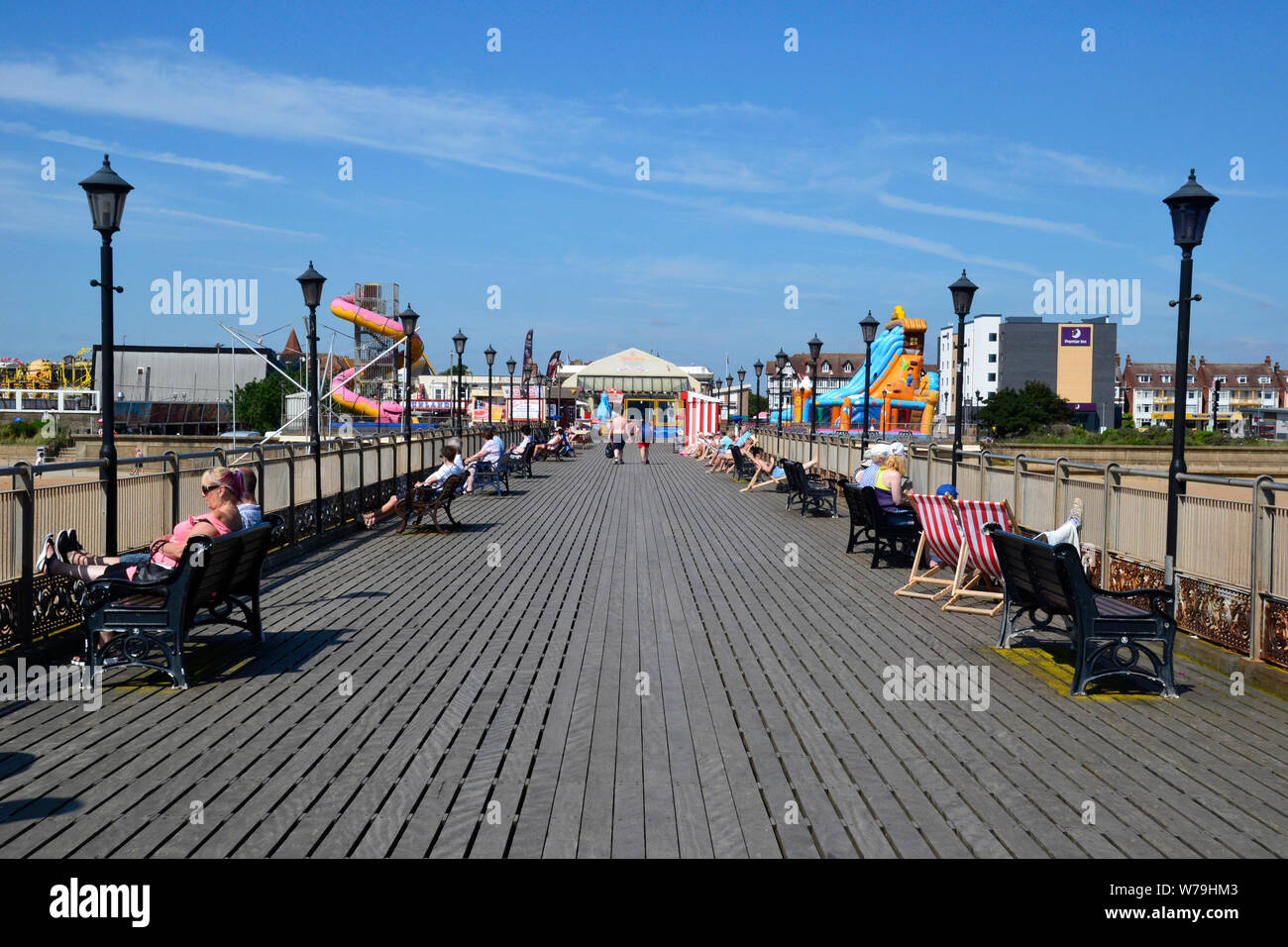 People relaxing on Skegness Pier, the seafront, Skegness, Lincolnshire, UK Stock Photo