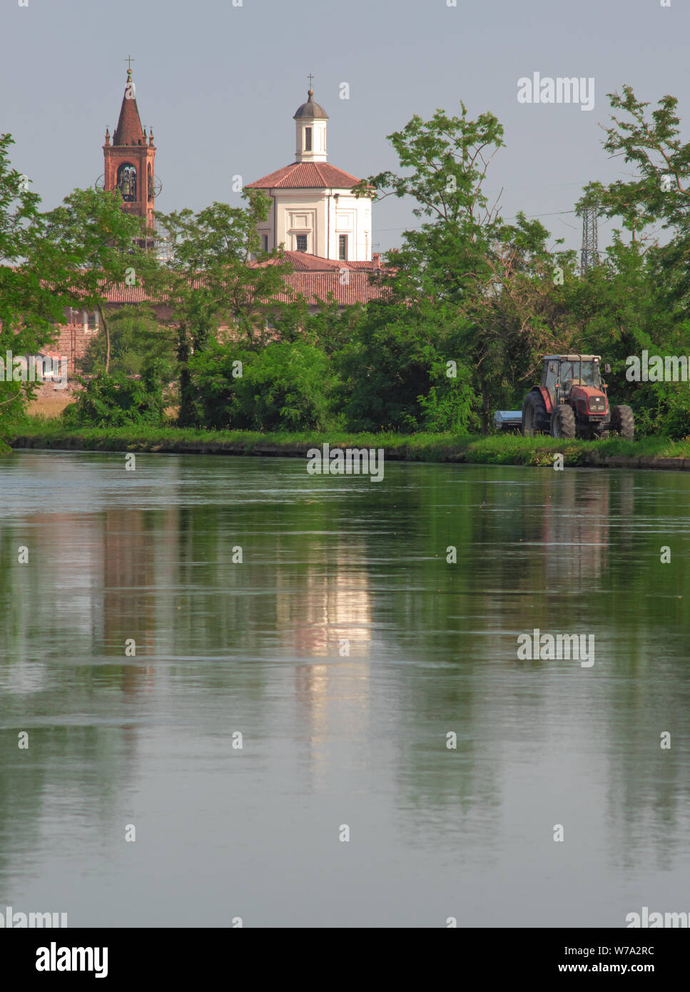 landscape on the outskirts of Milan, church reflected in the navigable canal of the Naviglio Grande Stock Photo