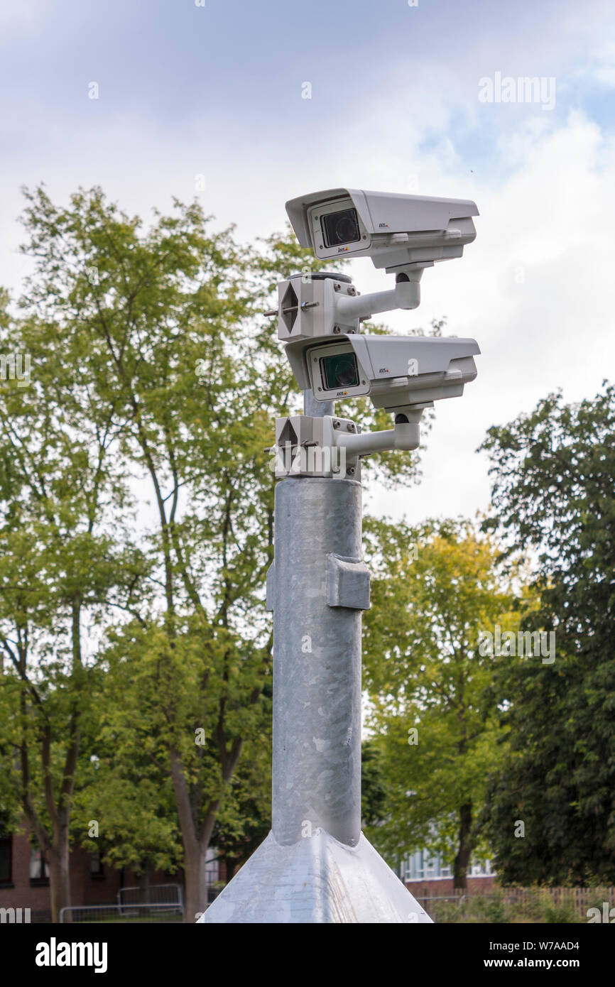 Multiple CCTV cameras mounted on post Stock Photo