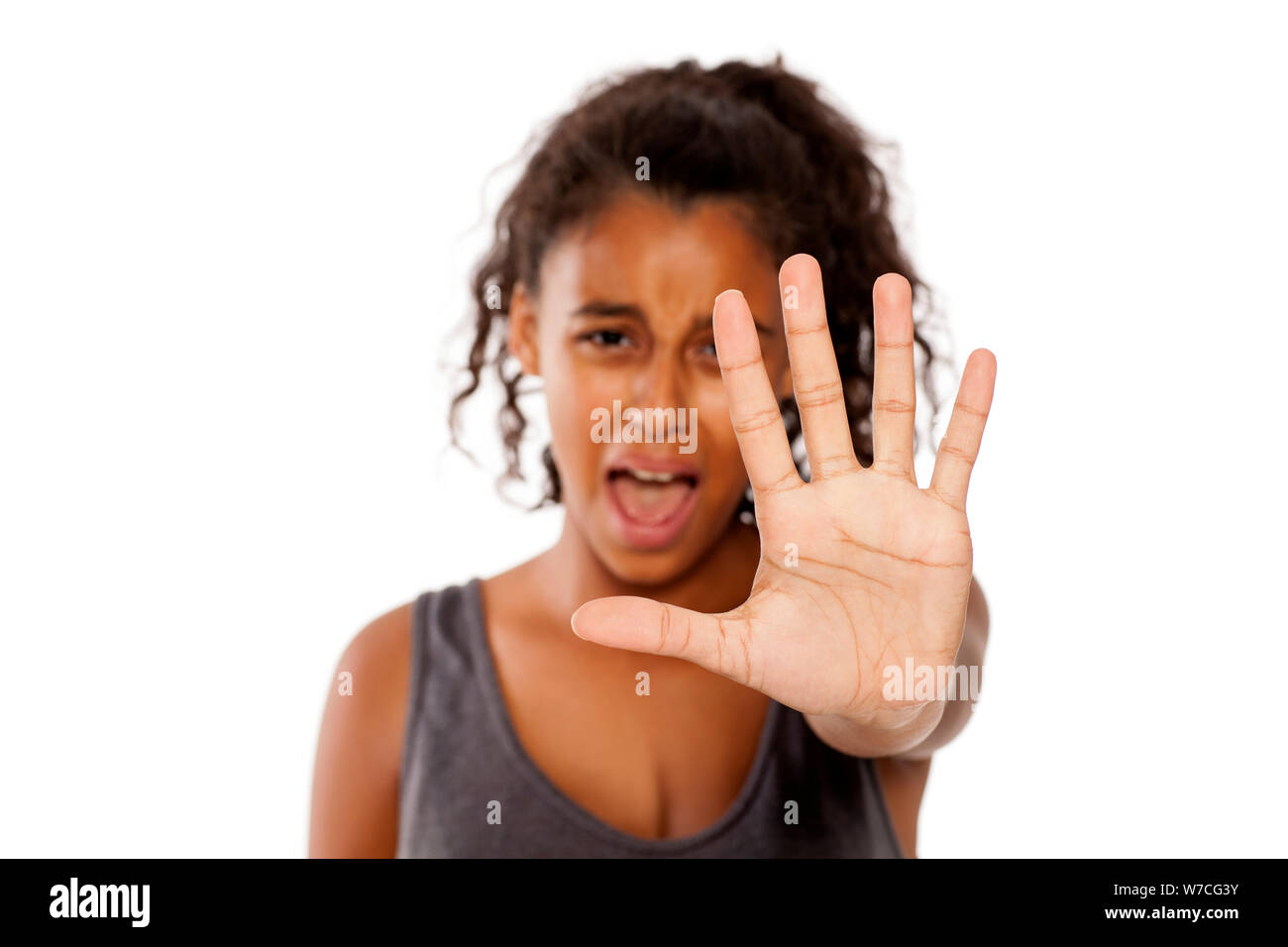 a scared african girl shows a stop hand Stock Photo