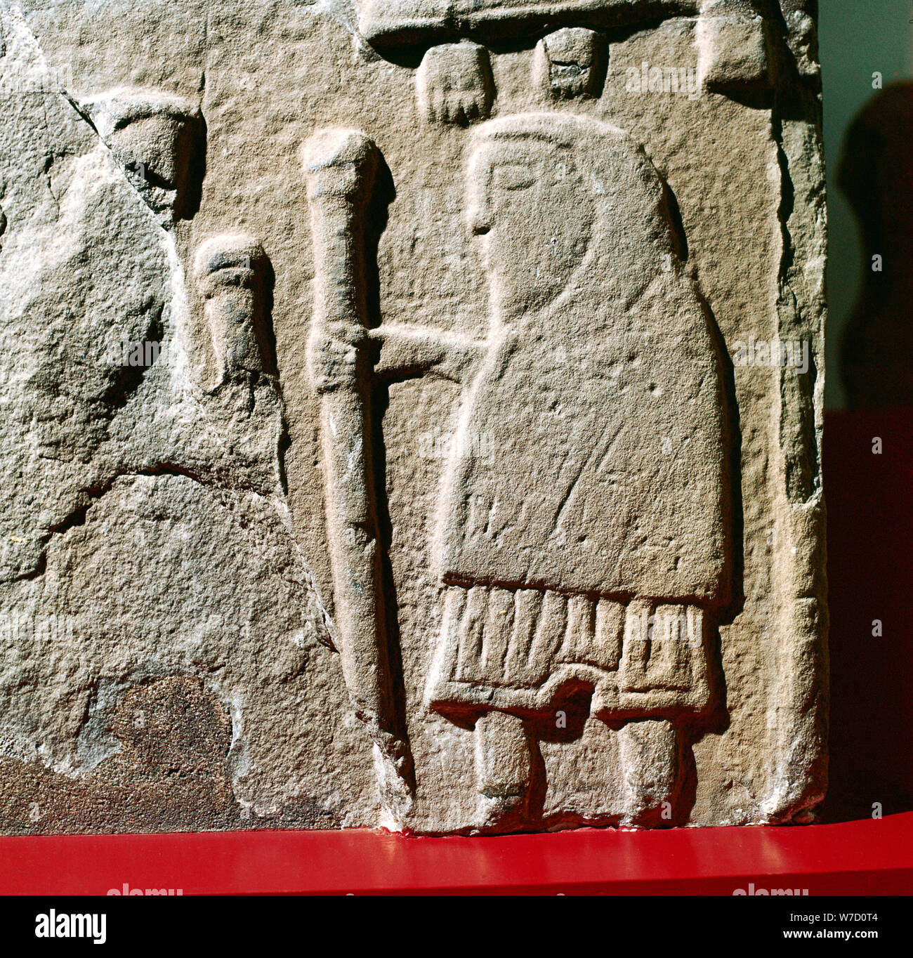 A Pict with hooded cloak & Pictish trousers, St.Vigeans, Scotland, c8th - 9th century. Artist: Unknown Stock Photo