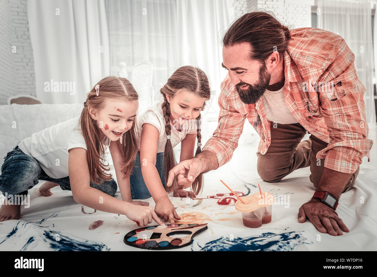 Good young father spending time together with his children painting Stock Photo