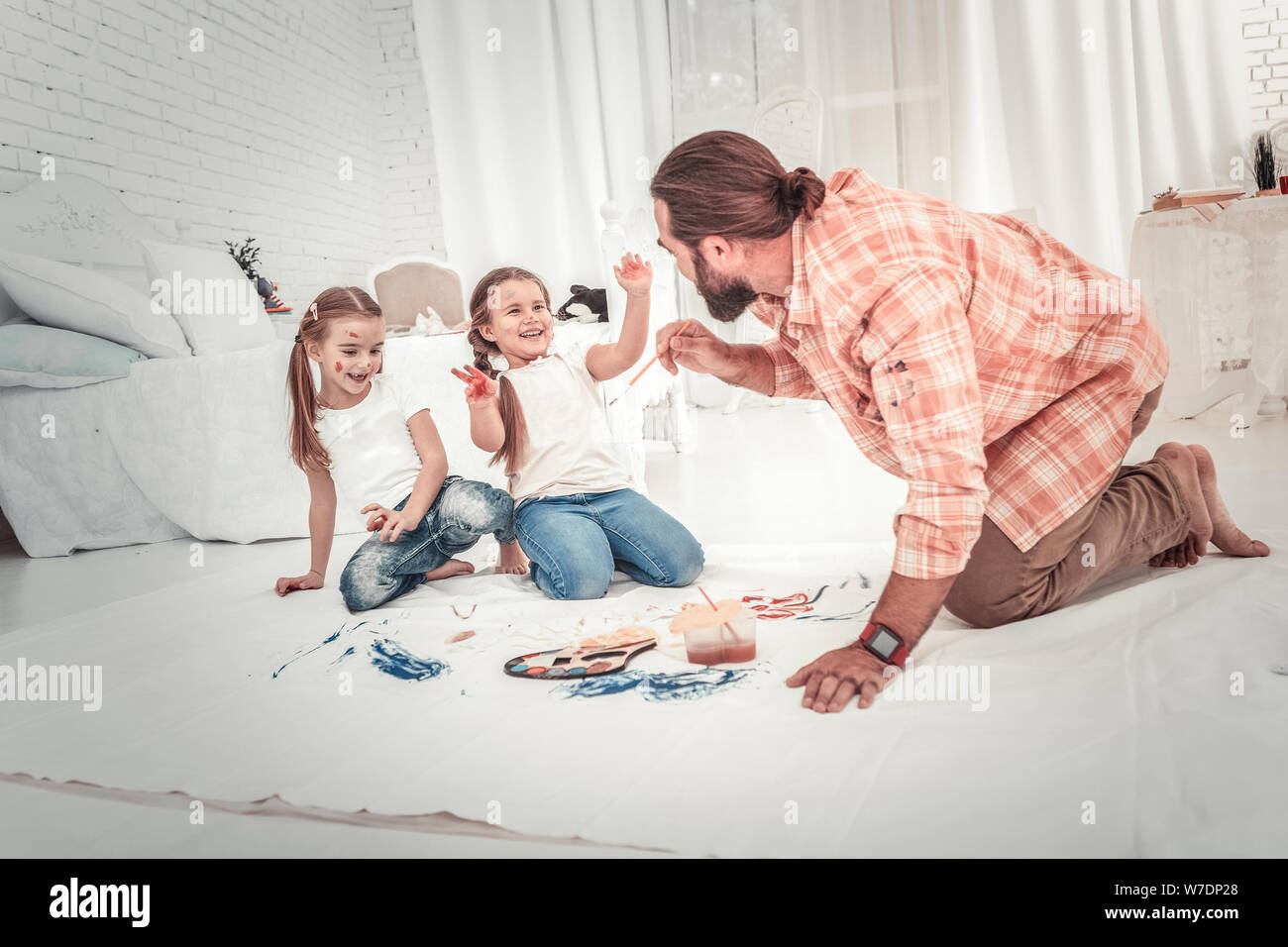 Smiling and happy kids drawing with their dad Stock Photo