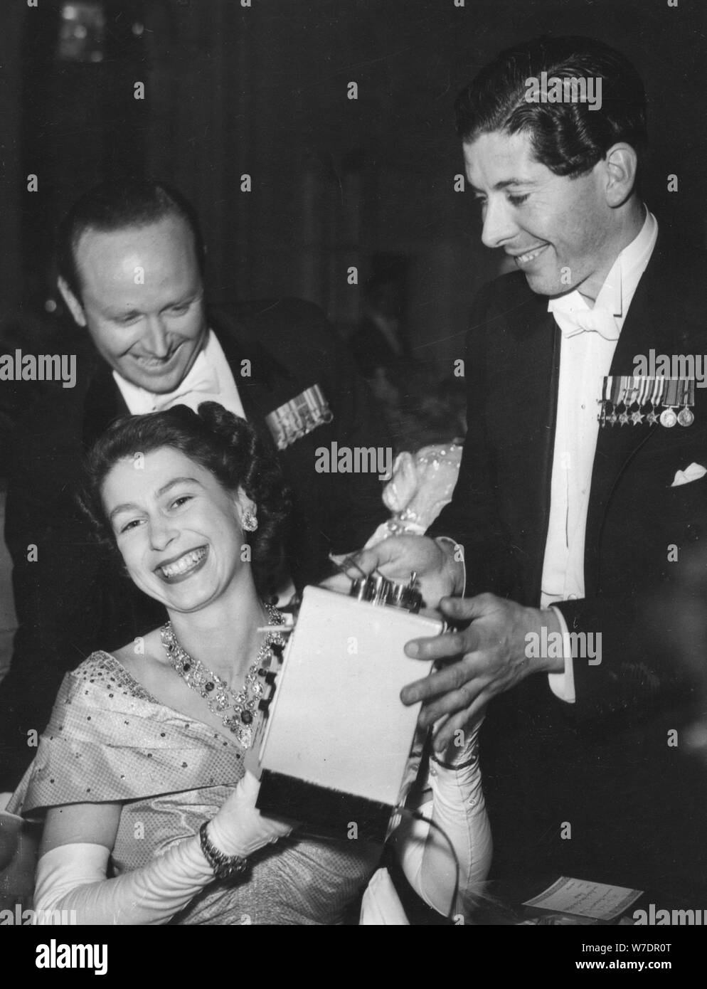 Princess Elizabeth receives a toy stove for Prince Charlesat the Flower Ball, Savoy Hotel, 1951. Artist: Unknown Stock Photo