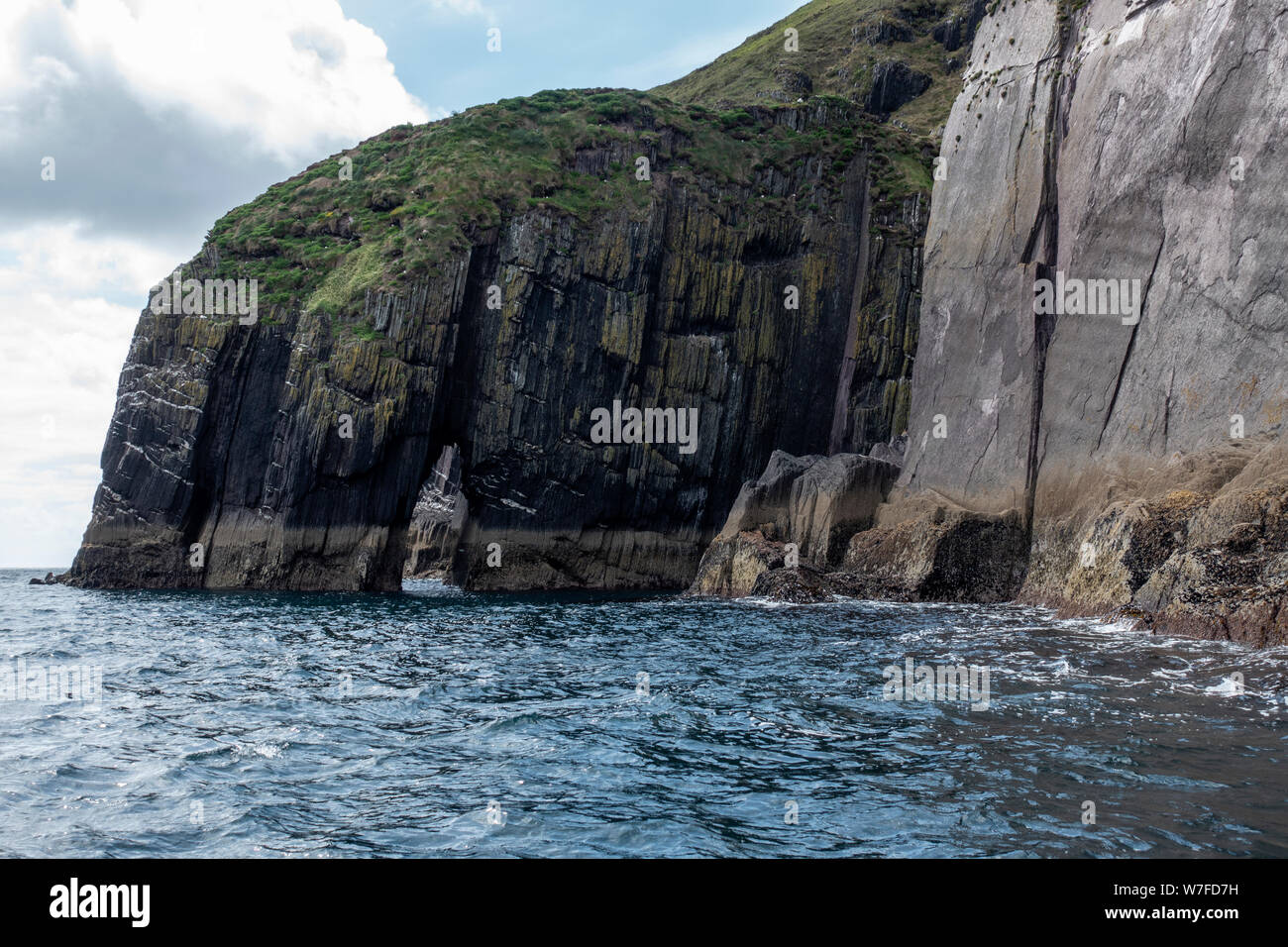 Sea arch viewed from boat - Dingle Peninsula, County Kerry, Republic of Ireland Stock Photo