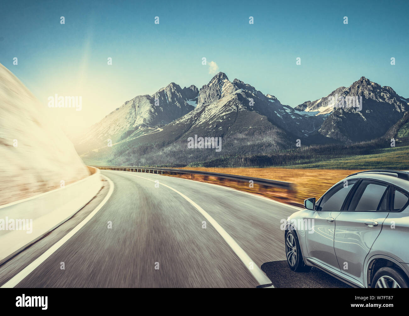Highway among the mountain scenery. White car on a mountain road. Stock Photo
