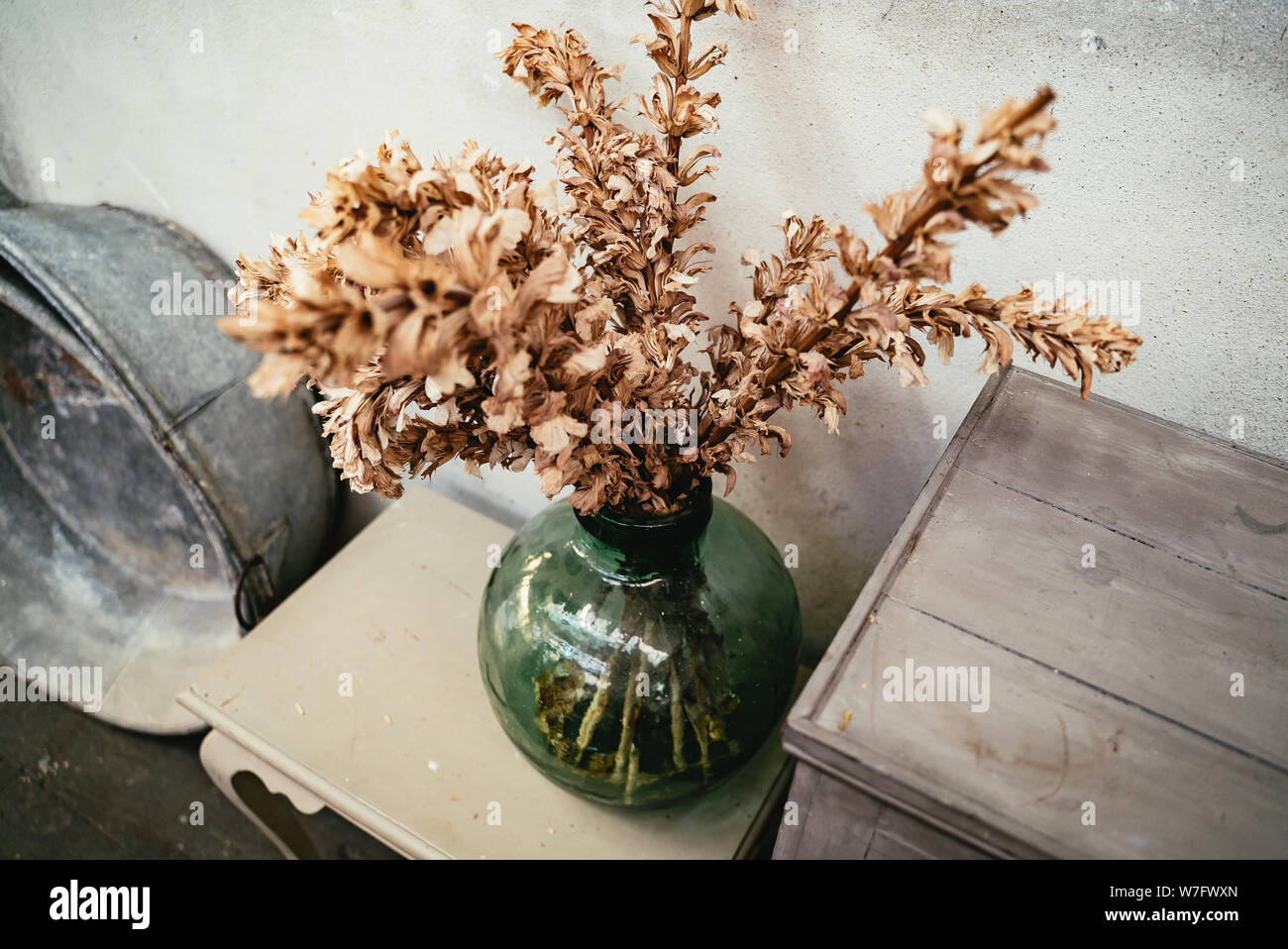 Green Glass Vase With Dried Flower Arrangement Stock Photo Alamy