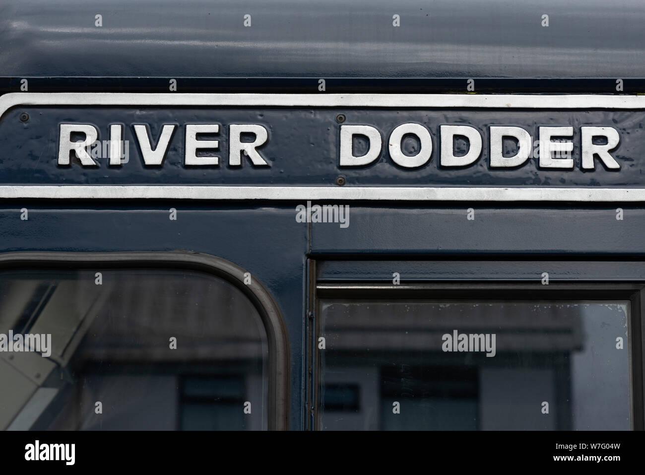 """River Dodder"" close up writing logo on a dark blue 201 Class diesel locomotive as the Belmond Grand Hibernian luxury sleeper dedicated locomotive. Stock Photo"