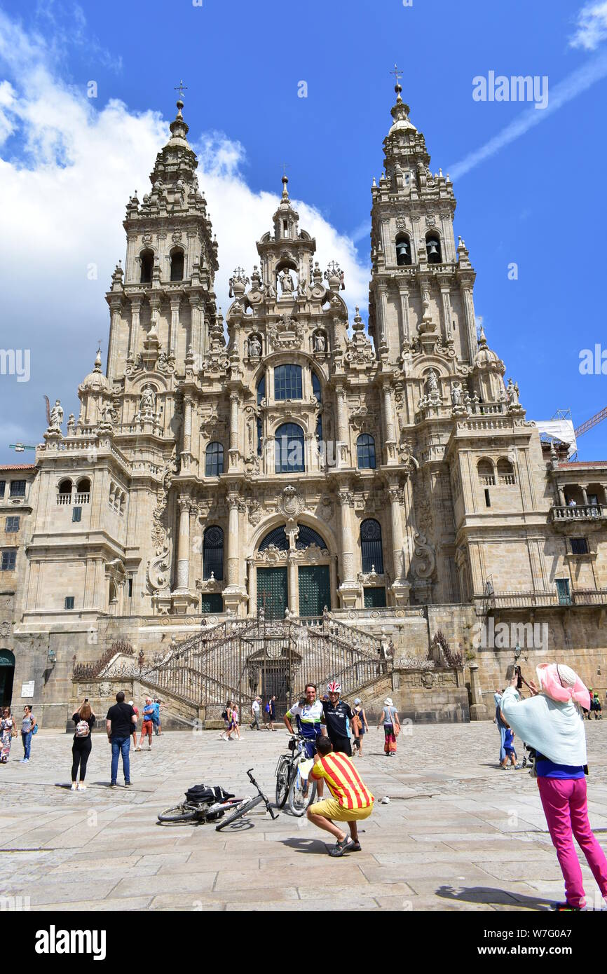 Cathedral and pilgrims taking pictures. Santiago de Compostela, Spain. August 3, 2019. Stock Photo
