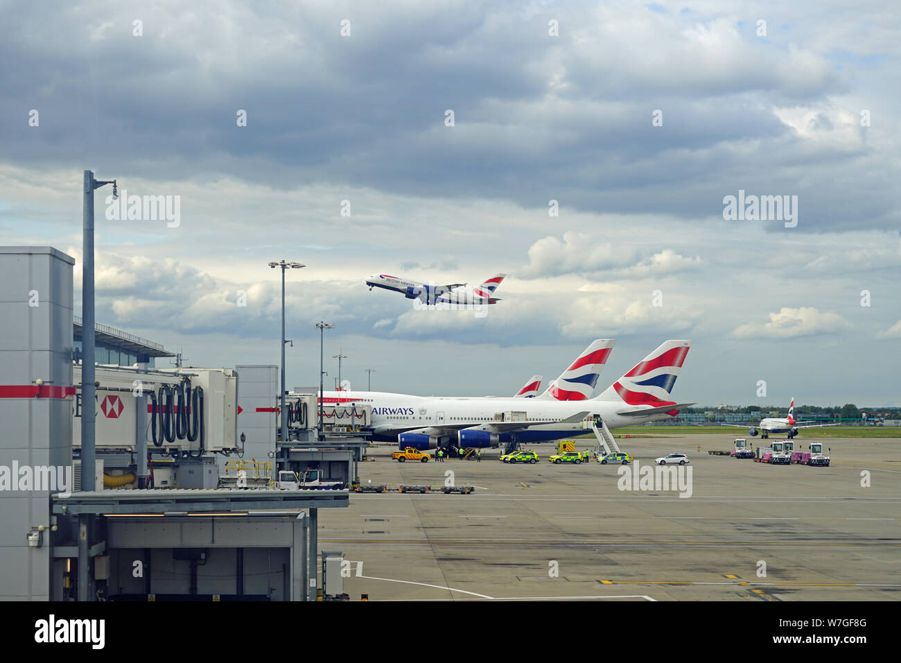 HEATHROW, ENGLAND -28 JUL 2019- View of an airplane from British Airways (BA) taking off at London Heathrow Airport (LHR), the main airport in London. Stock Photo