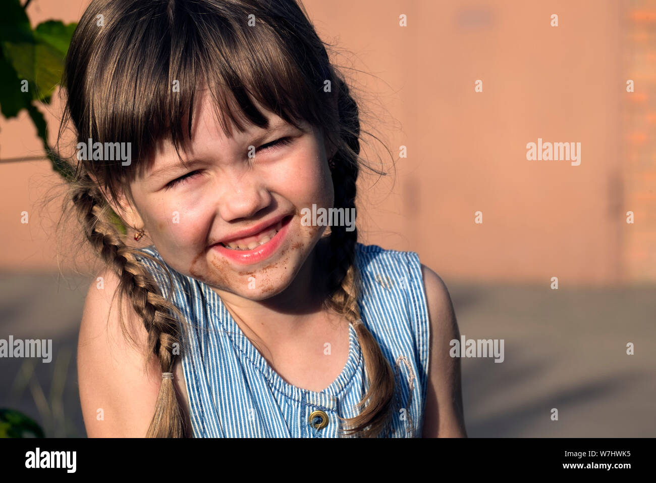 Little Muddy girl. Little naughty girl face smeared in chocolate Stock Photo