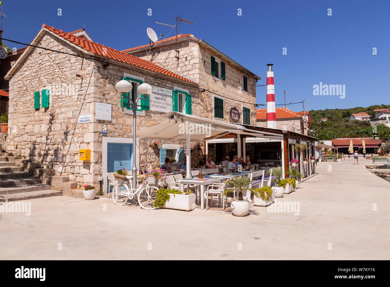 Cafe on the harbour at Maslinica on the Adriatic coast of Croatia Stock Photo