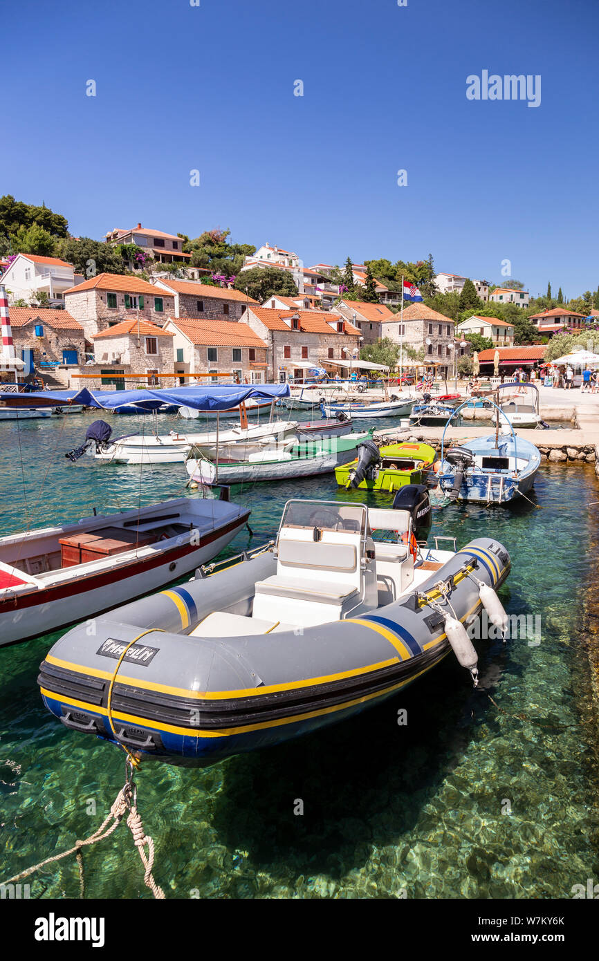 Boats moored in the harbour at Maslinica on the Adriatic coast of Croatia Stock Photo