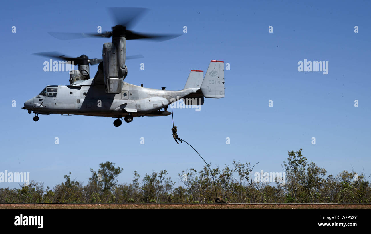 U.S. Marines with 3rd Battalion, 3rd Marine Regiment, a part of Marine Rational Force - Darwin (MRF-D), conduct fast rope training at Mount Bundey Training Area, Northern Territory, Australia on August 6, 2019. The training was conducted to enhance the Marines' skills when fast roping from a MV-22B Osprey aircraft in the event it cannot land, or a quick insertion is necessary. (U.S. Marine Corps photo by Cpl. Kallahan Morris) Stock Photo