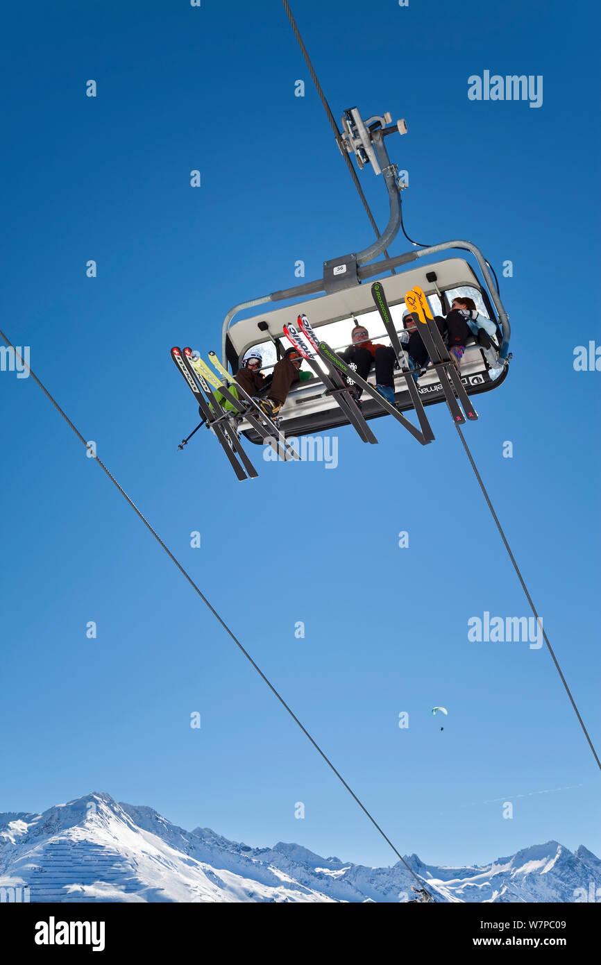 People on modern chairlift overhead, St Anton am Arlberg, Tirol, Austria, 2009 Stock Photo