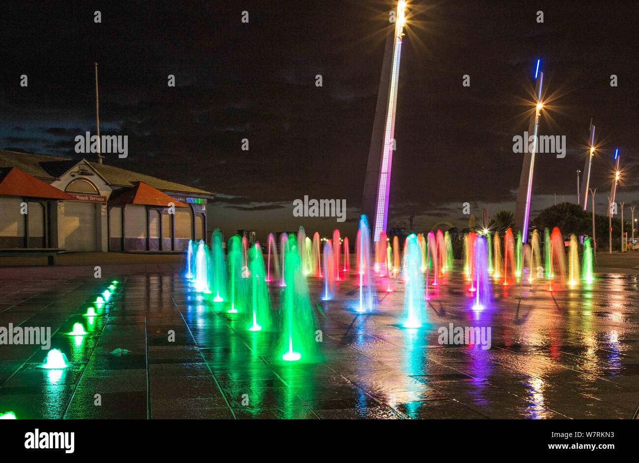 Night shot showing colourfully lit water display on Southend on Sea's promenade Stock Photo