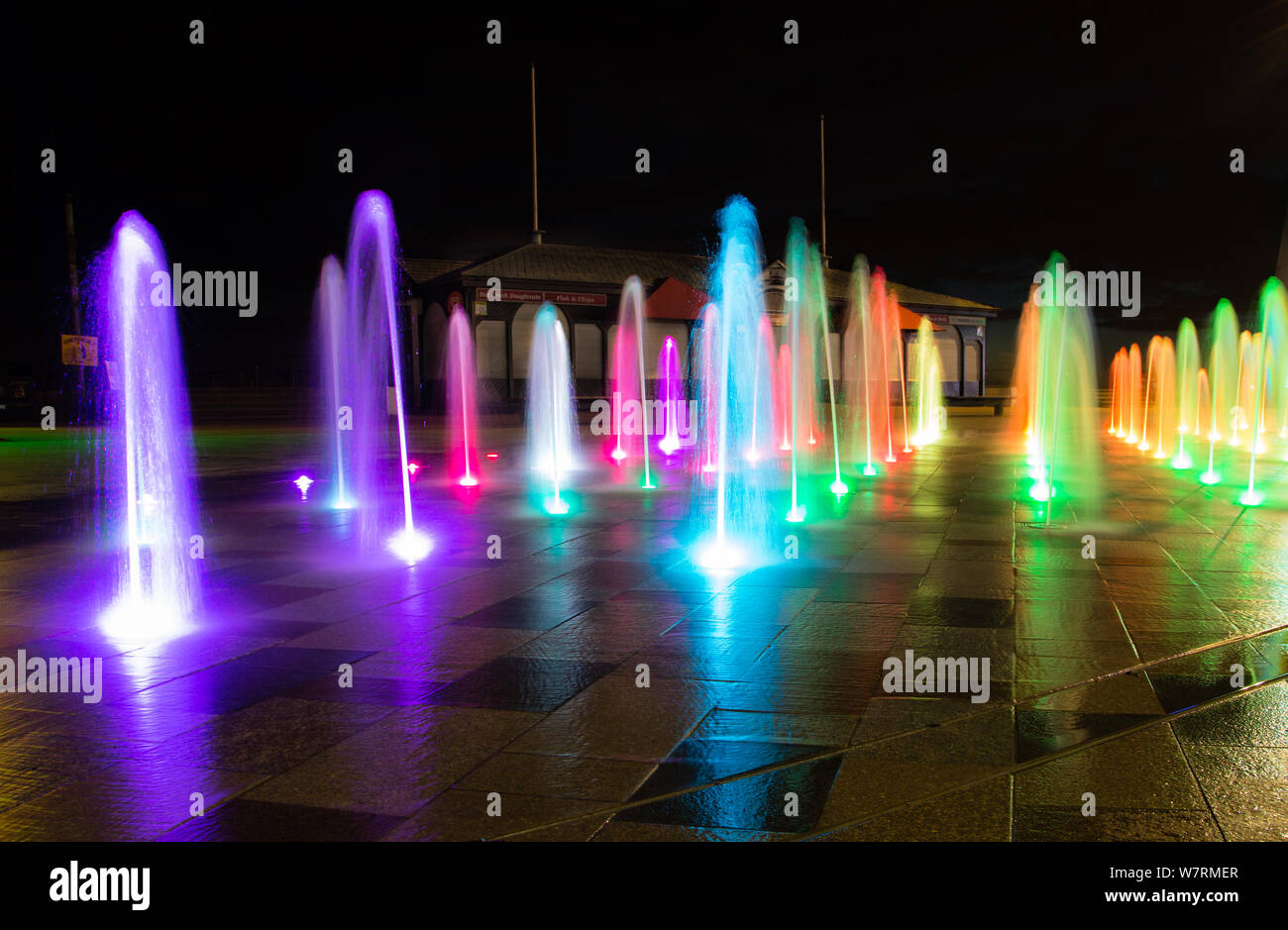 Water jet fountains on Southend on Sea front. Many coloured sprayed water jets Stock Photo
