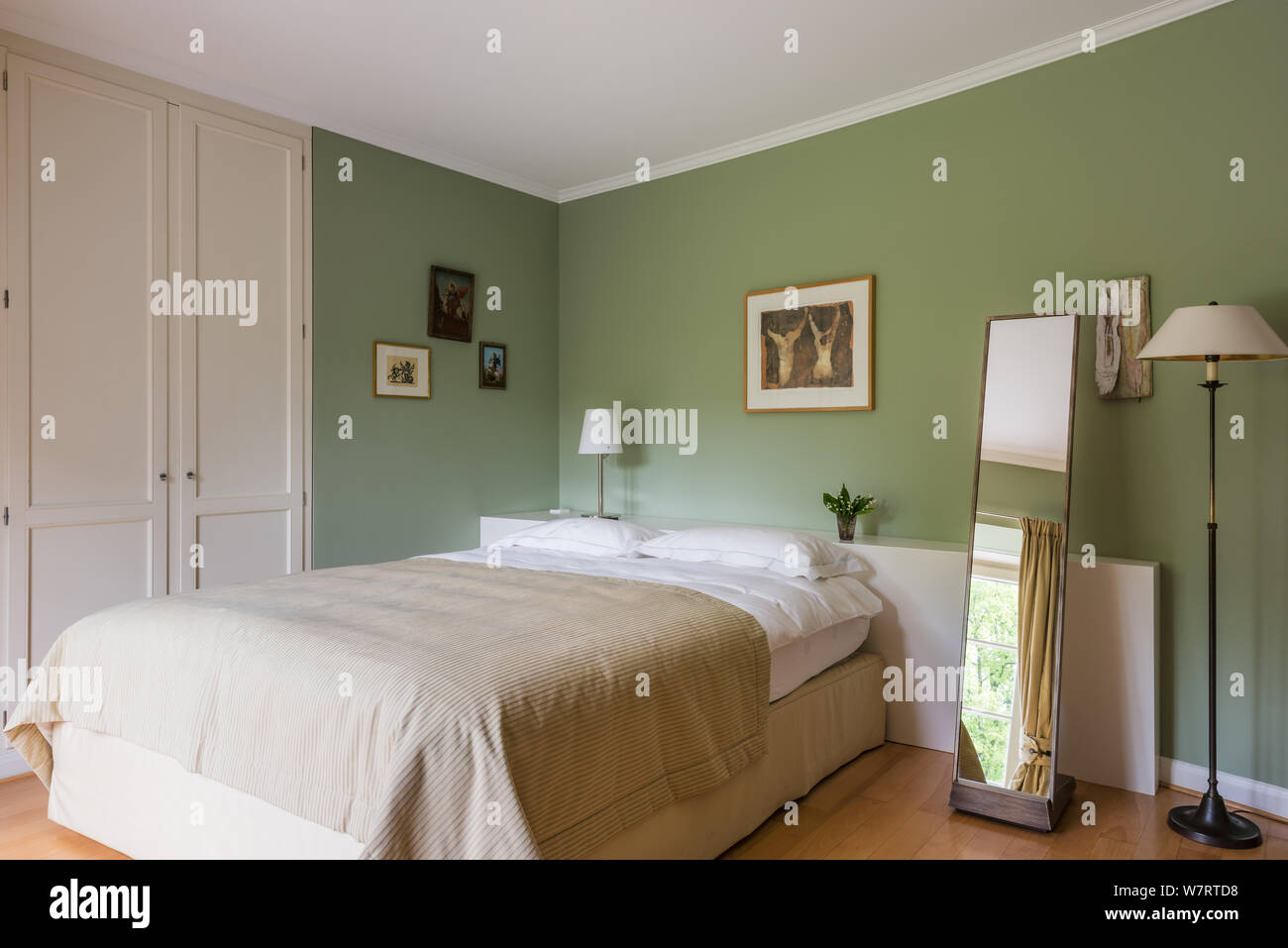 Green and white toned country style bedroom Stock Photo ...