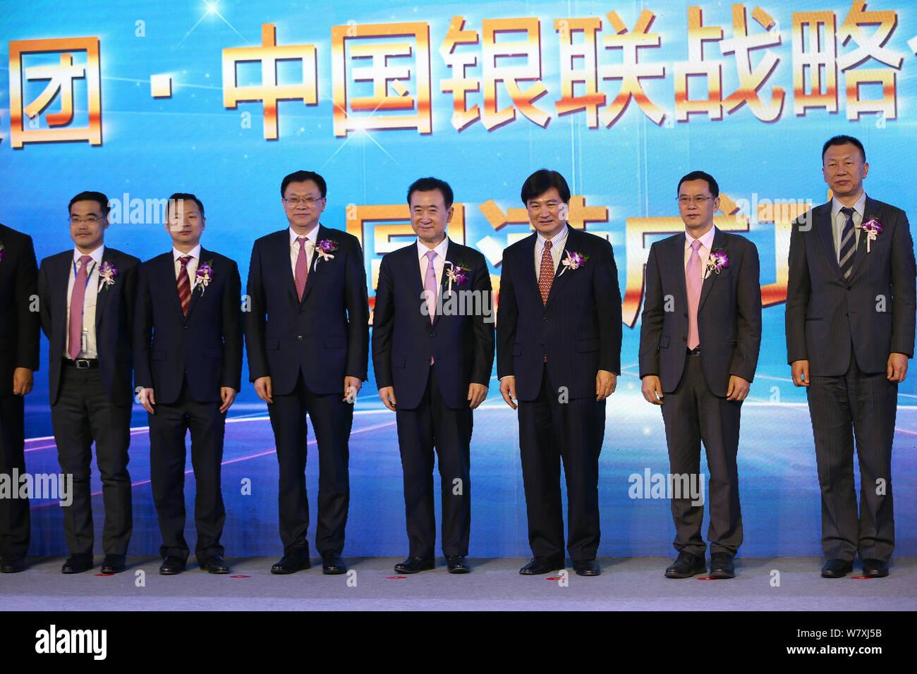 Wang Jianlin, center, Chairman of Wanda Group, and Ge