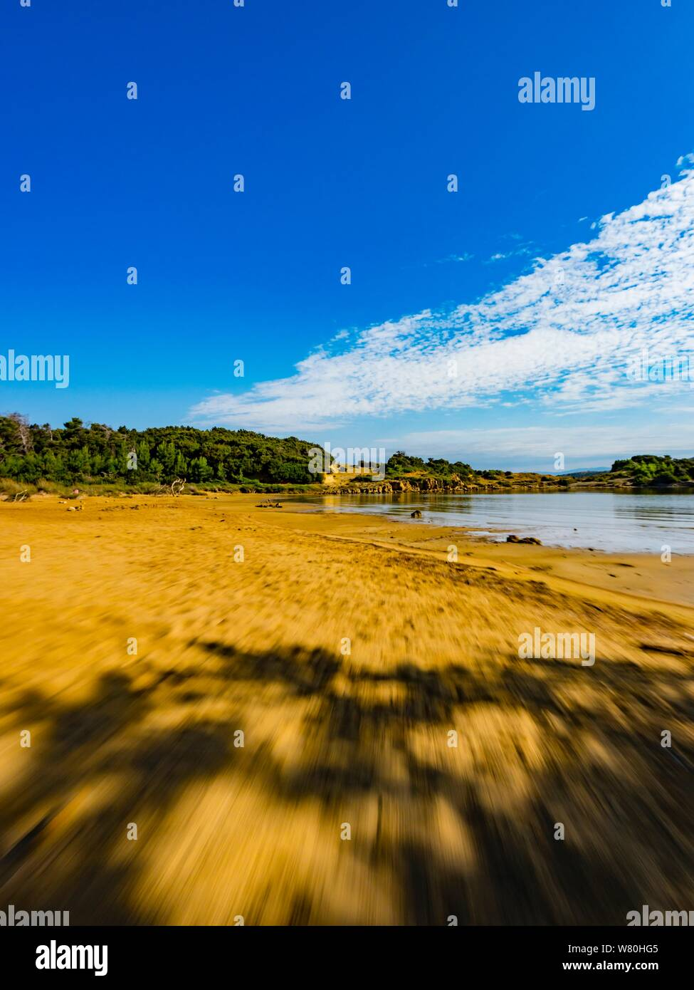 Sandy beach vacated vacant countryside speeding low view along Stock Photo