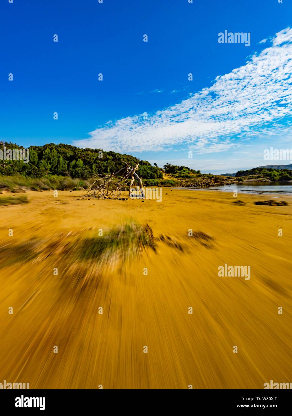 Sandy beach vacated vacant countryside speeding low view along wooden framework focused in center in distance Stock Photo