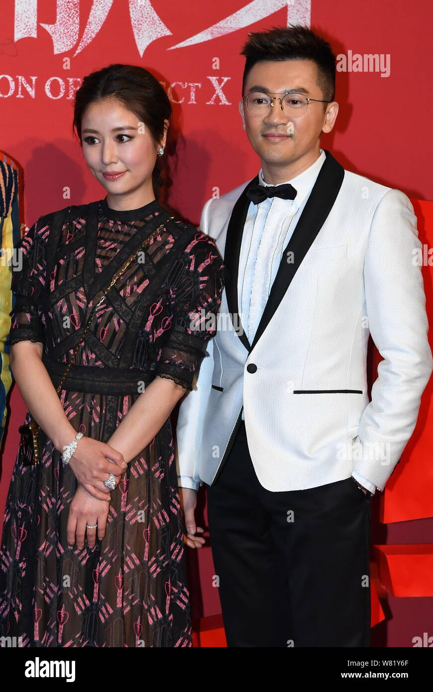Taiwanese actress Ruby Lin, left, and actor and director Alec Su pose at the premiere of their new movie ''The Devotion of Suspect X'' in Beijing Chin Stock Photo