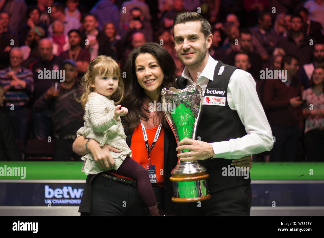 Mark Selby of England, right, poses with his family and champion ...