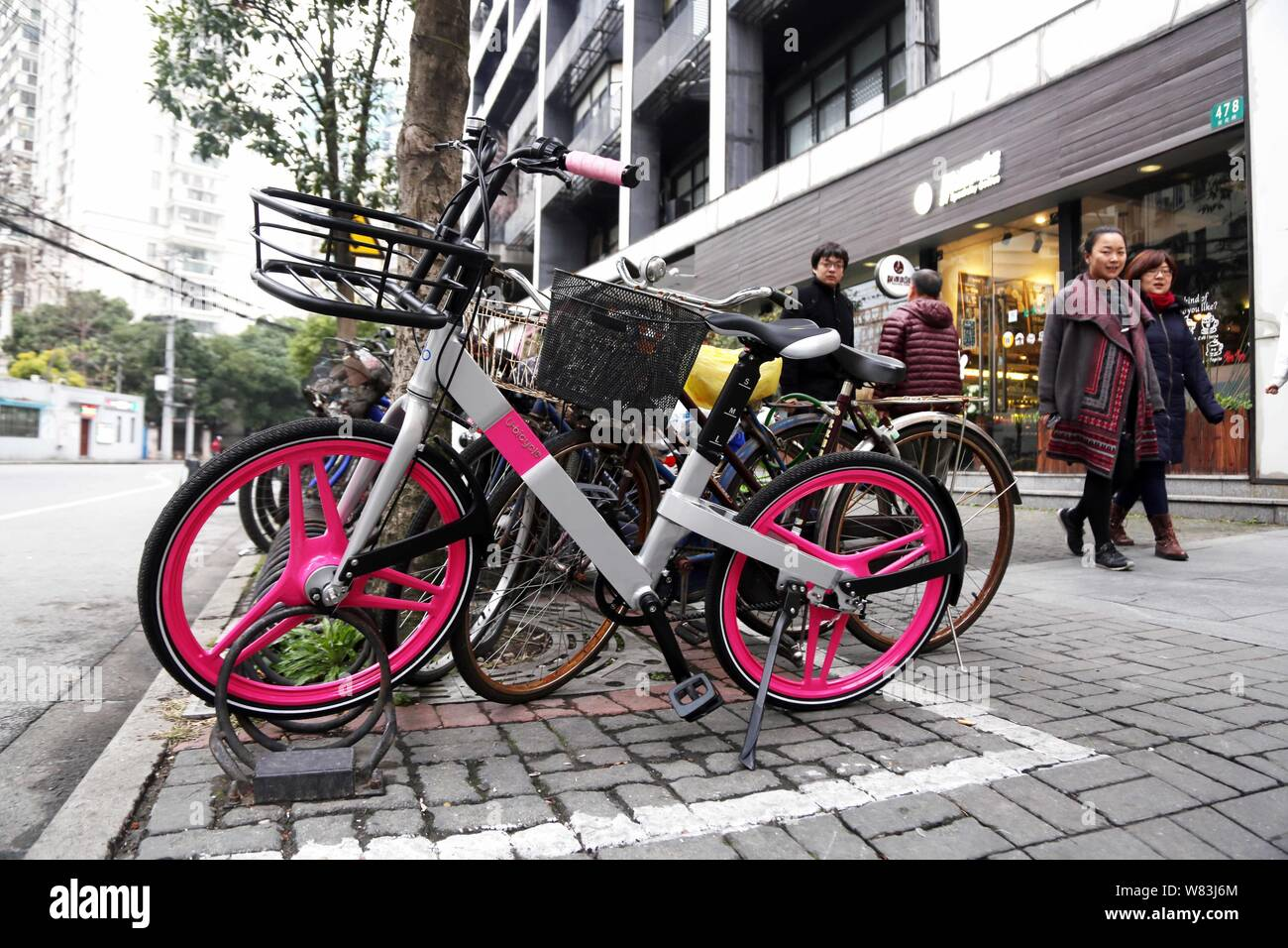 A bicycle of bike-lending service Ubike is seen on a road in Shanghai, China, 20 December 2016.   With China experiencing a booming sharing-economy, U Stock Photo