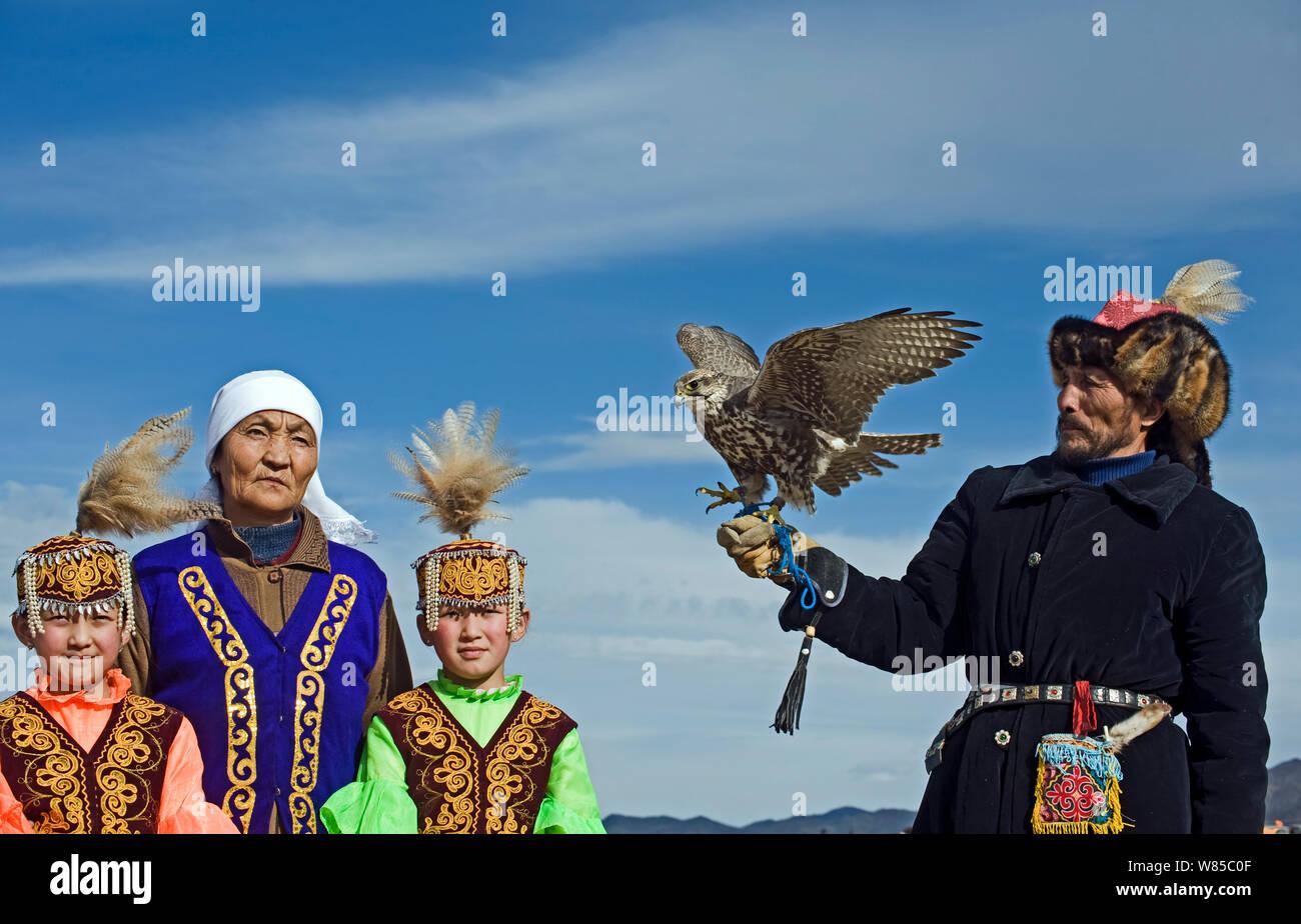 Kazakh hunter with Saker Falcon (Falco cherrug) at Eagle hunters festival near Ulgii, western Mongolia, October 2008. Stock Photo