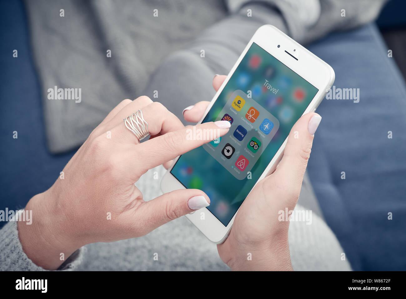 Kyiv, Ukraine - January 24, 2018: Woman using travel apps on