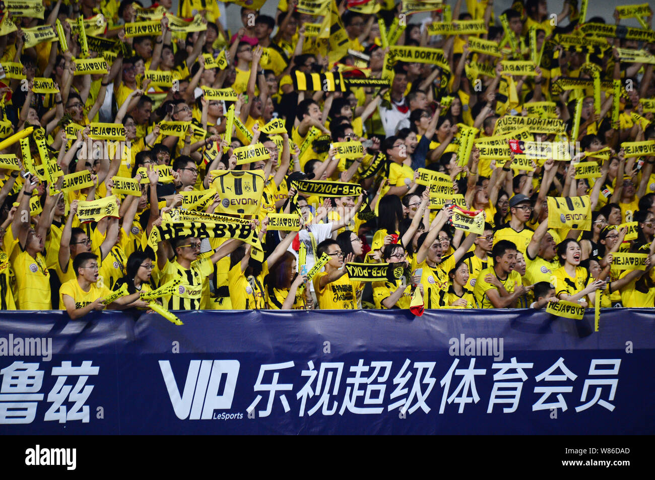 Chinese Football Fans Hold Up Banners And Shout Slogans To Show Support For Borussia Dortmund Competing Against Manchester United During The Shanghai Stock Photo Alamy