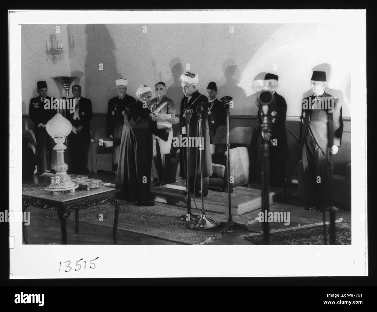 'Coronation' of King Abdullah in Amman. Sheik handing King Abdullah proclamation of the crowning Stock Photo