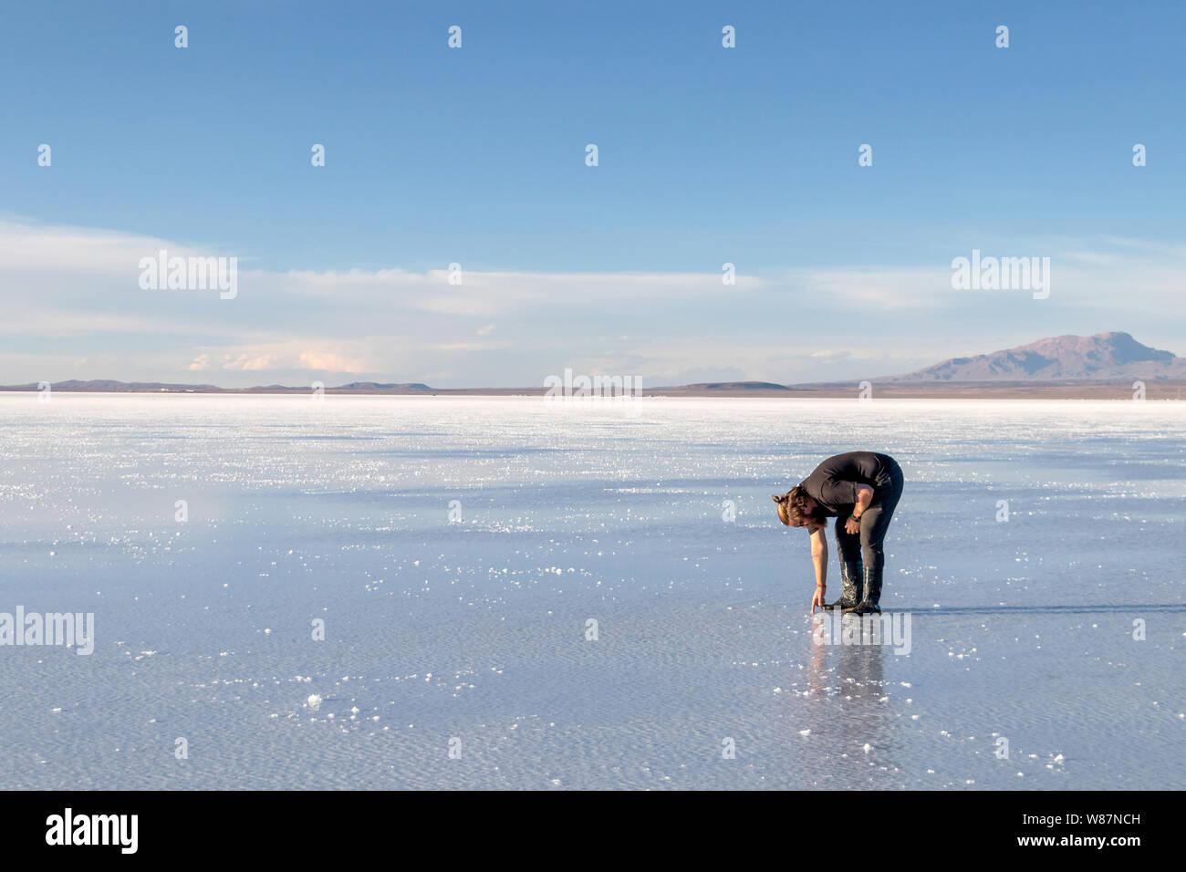 Water Mirror In Salar De Uyuni Uyuni Bolivia Tourists