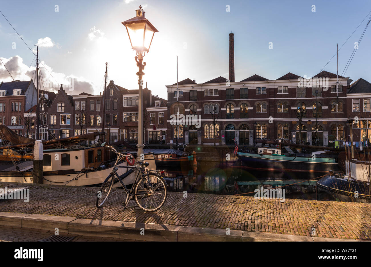 Old historic district Delfshaven with houseboats and traditional Dutch bike in Rotterdam, South Holland, The Netherlands Stock Photo