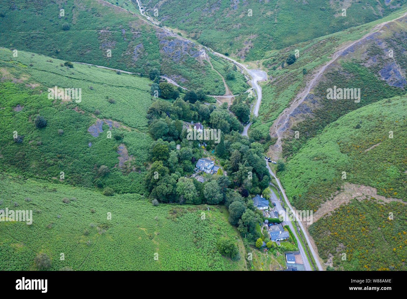 Aerial shoot over green slopes of Carding Mill Valley in Church Stretton, Shropshire, UK Stock Photo
